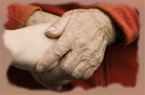 Older persons's hands holding younger persons's hands representing care and compassion of hospice volunteers